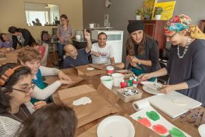 ETTA day program clients create crafts in honor of the Rosh Hashana holiday with volunteer Lynn Menlo and ETTA's Leah Schachter.